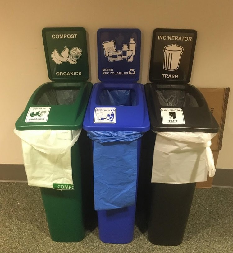 waste station with compost, trash, and recycling bins side by side