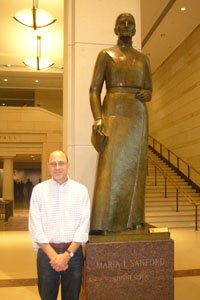 John Caskey with a statue of Maria Stanford