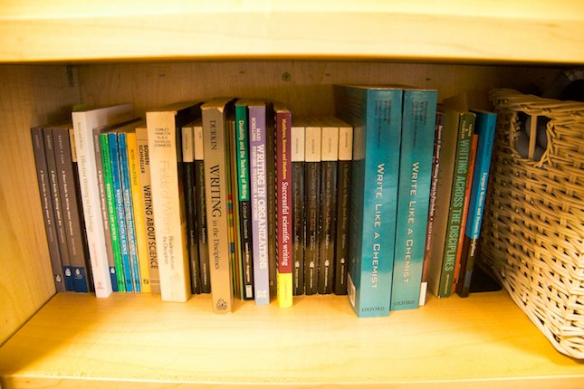 Image of Writing Center books lined up on a shelf