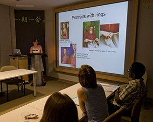 A student presents slides in Art History
