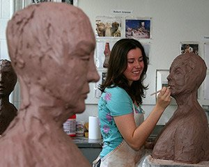 A student works on her sculpture