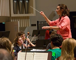 A student composer leads the student orchestra