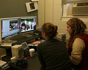 Students work on editing a film