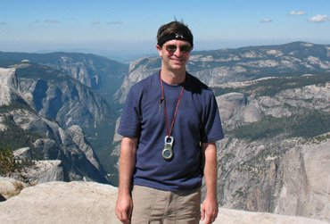Professor Rablen standing with arid mountain range in the background