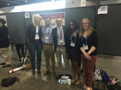 Chris and Zeke with other Albright people at a poster during the ACS meeting