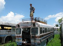 Anson standing on the roof of a bus