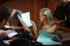 Students look over their schedules during the Department Advising Fair in Upper Tarble on August 30, 2012.