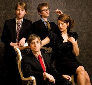 The Gregory Brothers, including Andrew '04 (standing, left) and Evan '01 (seated).