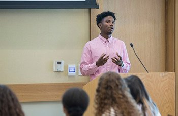 Rasheed Bryan '20 speaks at a podium