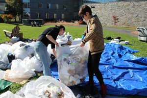 Students sort through the waste collected during the trash audit.