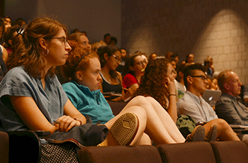 Students sit in an auditorium