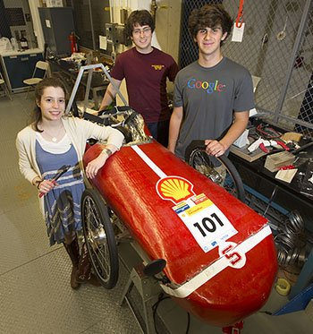 Students stand with their eco car