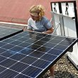 Izzy Branco-Lo '18 installs solar panels.