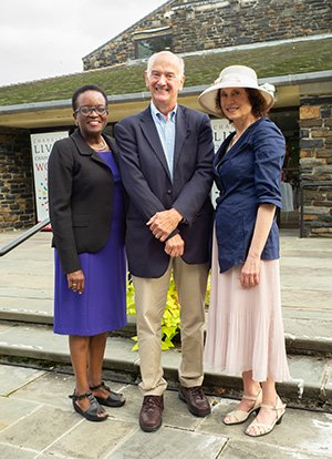 Valerie Smith, Gil Kemp '72 and Barbara Guss stand in front of Sharples