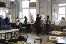 Professor Logan Grider guiding students in Painting I class.