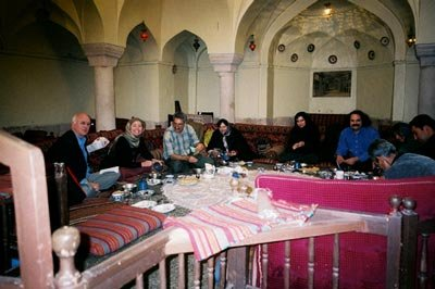 People gathered at table in Tehran