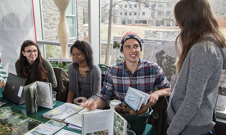 Students at table at sustainability showcase