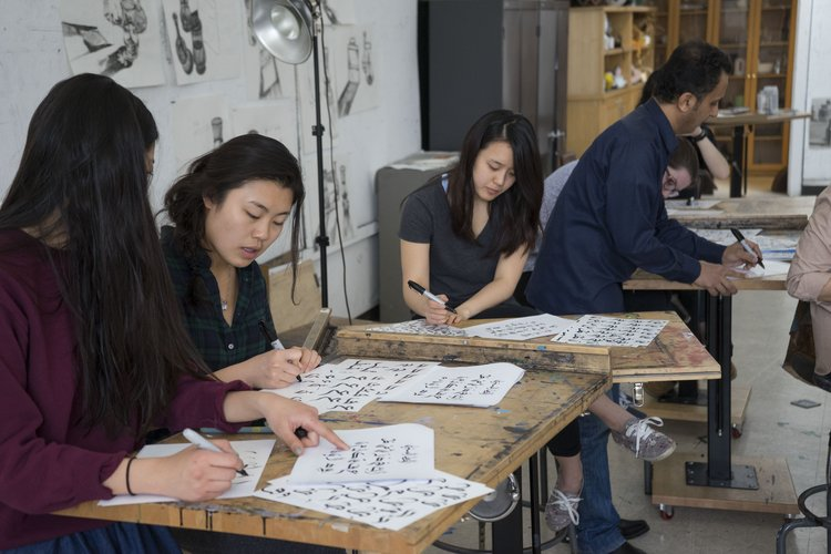 Students practicing calligraphy