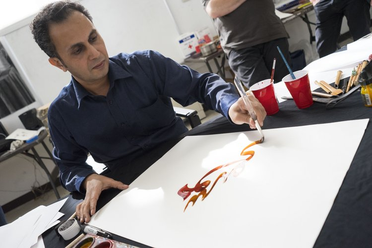 Khaled al-Saai providing a calligraphy demo