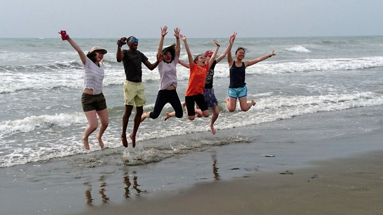 Chinese section study abroad group photo jumping at beach