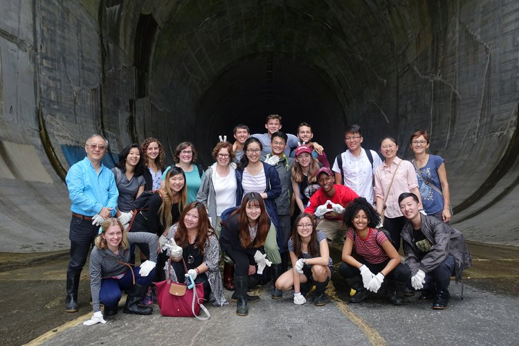 Chinese section study abroad group photo at tunnel