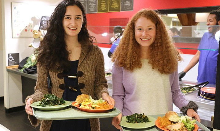 Students with food at harvest dinner