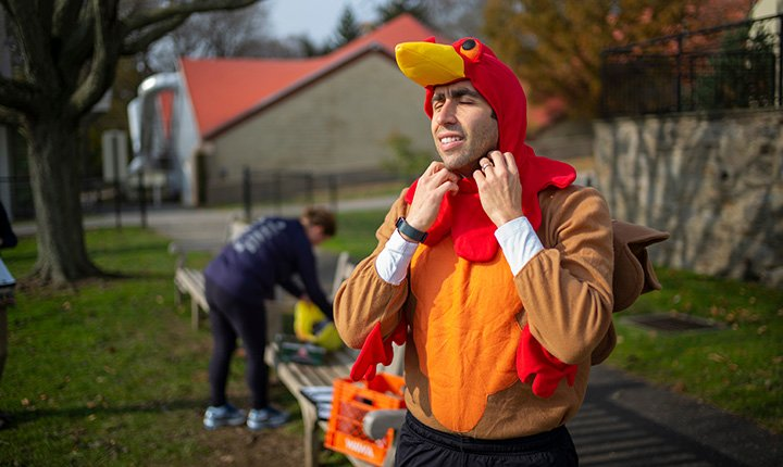 Max Miller puts on turkey costume outside for turkey trot