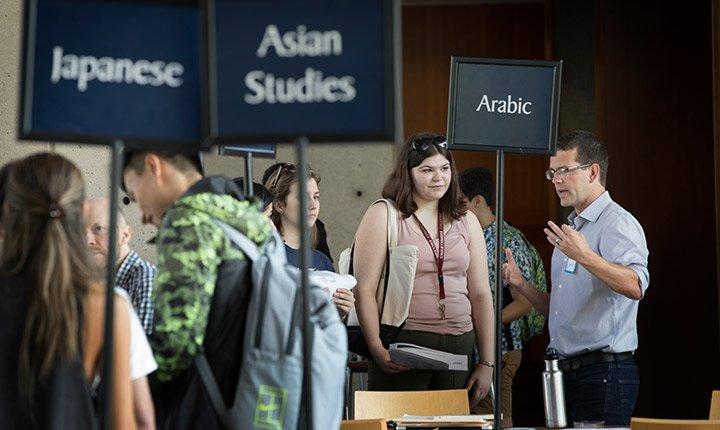 Students talk to advisors at the advising fair