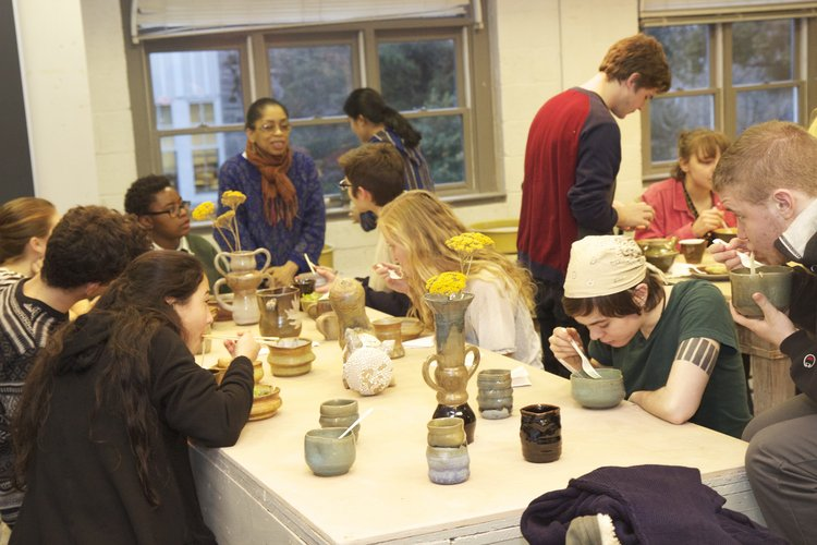 Professor Syd Carpenter hosts the Container as Architecture end-of-semester potluck dinner using their ceramic artwork creations.
