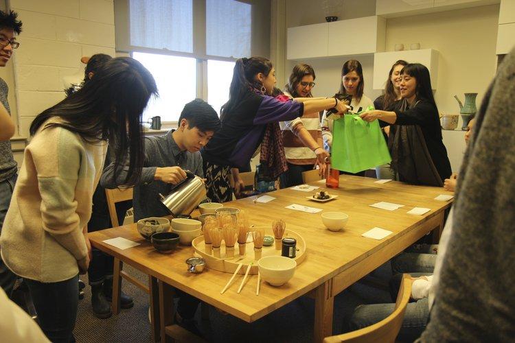 Professor Tomoko Sakomura leading a tea demonstration during Crafting Nature: The Art of Japanese Tea Culture.