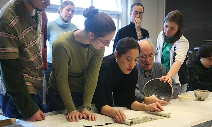 Students examine Japanese scrolls in art history class