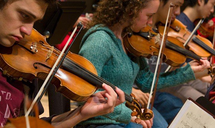 Orchestra students playing violin