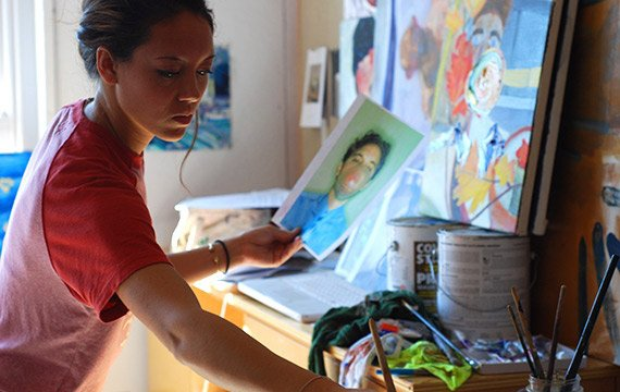 A student works in her art studio in Beardsley Hall