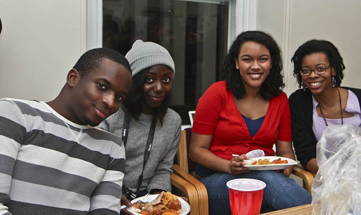Students enjoy good food and good company at the Black Community Center's annual Thanksgiving Dinner.