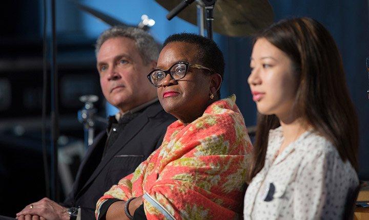 President Valerie Smith listens on