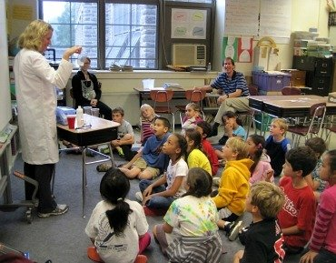Professor Kathleen Howard teaches third-graders from a nearby school all about polymers.