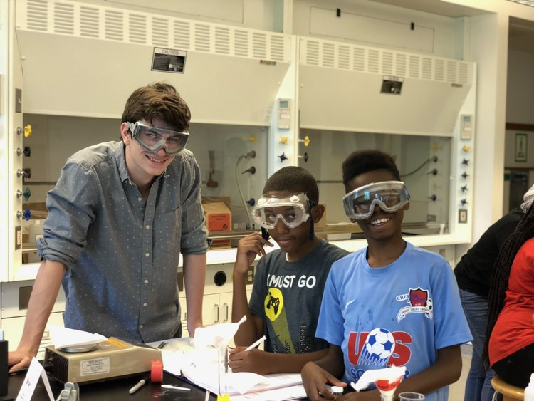 Swarthmore chemistry students work with middle school students as part of the Science for Kids program.