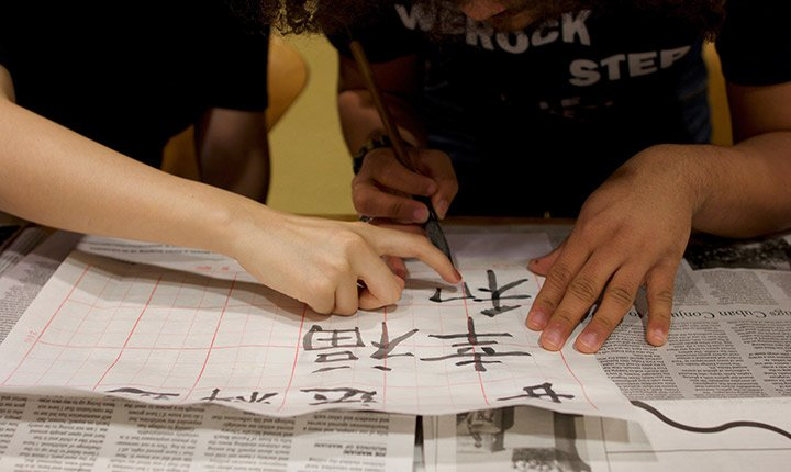 A student learns calligraphy