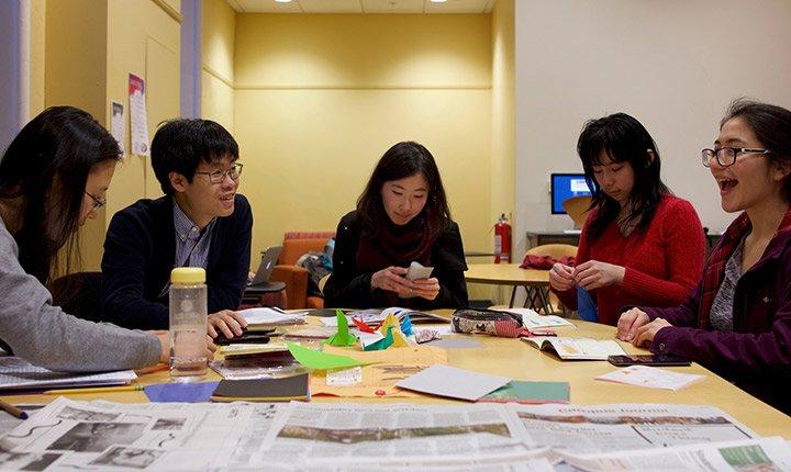 Students practice origami