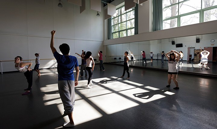 A dance class rehearses in the studio