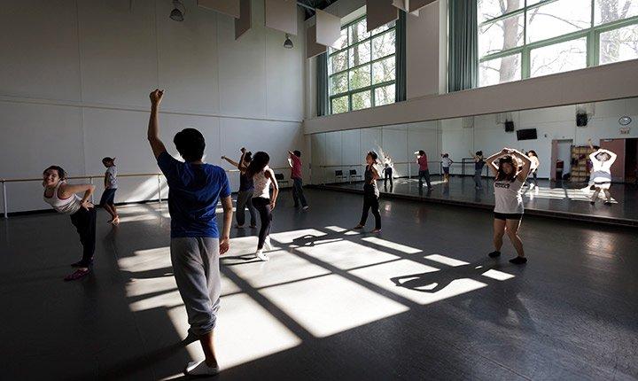 A dance class rehearses in the studio