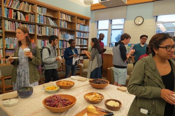 Students talking to professors at Ed Introduction Party