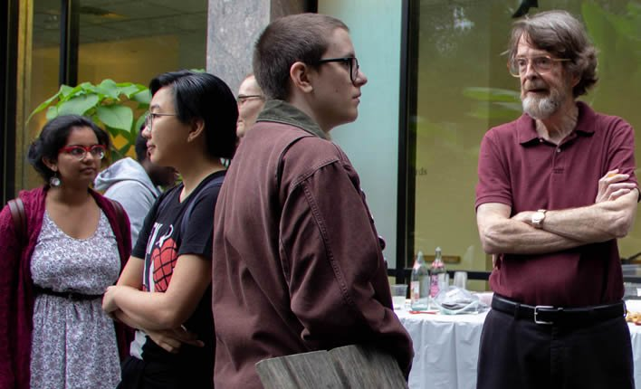 Students and faculty speaking at English Fall party