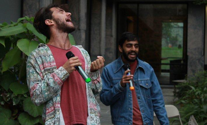 Students enjoying karaoke at English Fall party