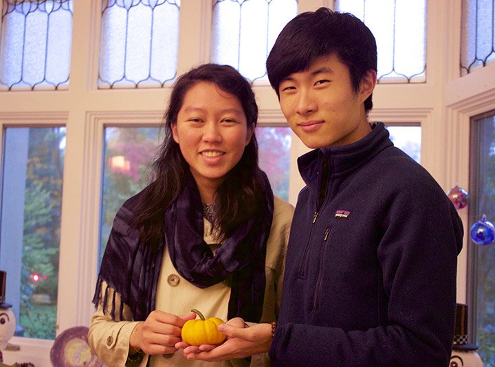 Two students with a pumpkin
