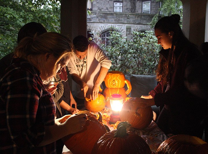 Students carve pumpkins