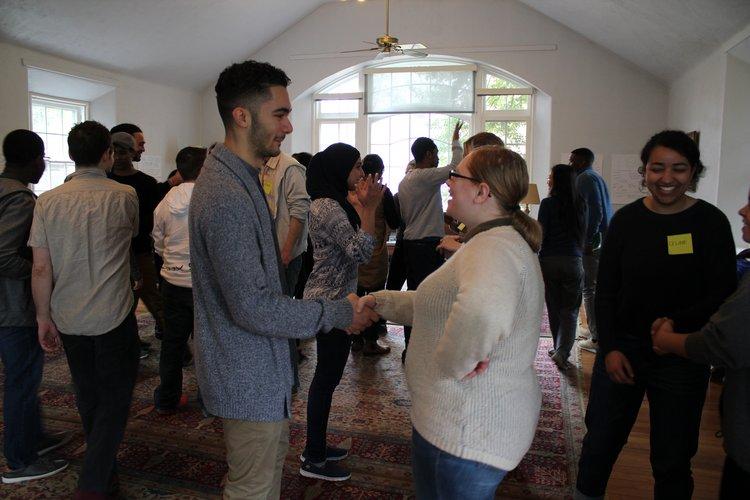 People shaking hands at Kayhan Irani workshop