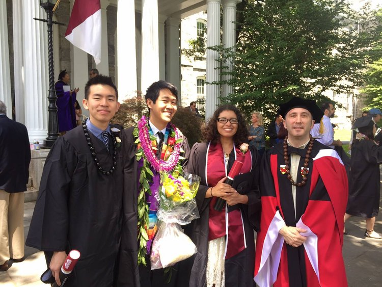 Students stand with Professor Will Gardner at Commencement 2017