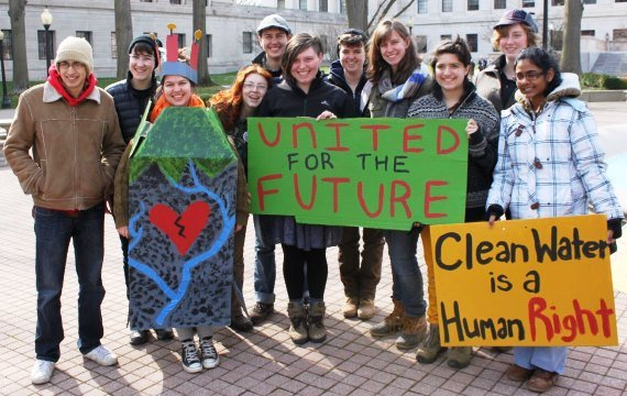 Group of students holding signs at an environmental demonstration