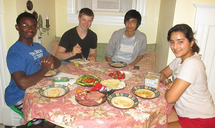 Lab members Deondre Jordan '19, Barrett Powell '18, Sayed Malawi '18, and Amber Sheth '18 prepare dinner together upon arriving in Louisville.
